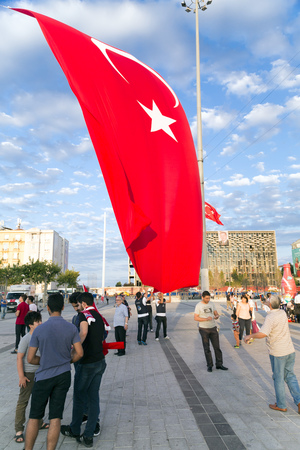 recep tayyip erdogan: Istanbul, Turkey - July 23, 2016: Turkish people gathering and waving flags at Taksim Square. The meetings were called Duty for Democracy after the failed July-15 coup attempt of Gulenist militants.