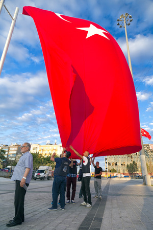 Istanbul, Turkey - July 23, 2016: Turkish people gathering and waving flags at Taksim Square. The meetings were called Duty for Democracy after the failed July-15 coup attempt of Gulenist militants.