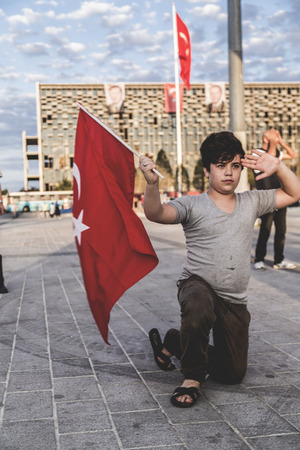 turkish flag: Istanbul, Turkey - July 23, 2016: Turkish people gathering and waving flags at Taksim Square. The meetings were called Duty for Democracy after the failed July-15 coup attempt of Gulenist militants.