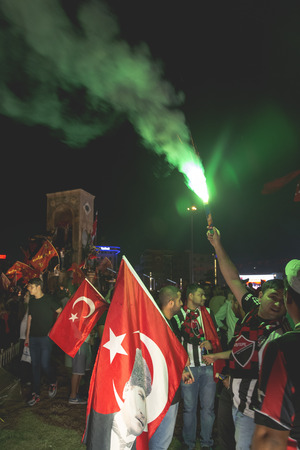 turkish people: Istanbul, Turkey - July 23, 2016: Turkish people and football clubs supporters at Taksim Square. The meetings were called Duty for Democracy after the failed July-15 coup attempt of Gulenist militants
