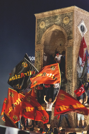 Istanbul, Turkey - July 23, 2016: Turkish people and football clubs supporters at Taksim Square. The meetings were called Duty for Democracy after the failed July-15 coup attempt of Gulenist militants