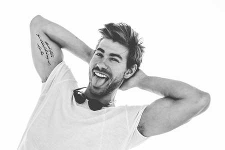 Young and attractive blonde man portrait, black and white male headshot Stock Photo