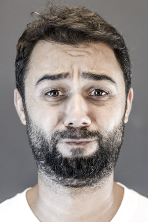 funny bearded man: Man making a funny face expression