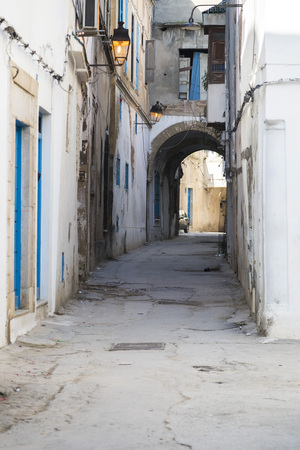 moorish clothing: View from the streets of the Medina of Tunis, Tunisia. Typical Tunisian architecture with Arab and Mediterranean influences. Stock Photo
