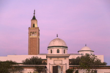 The minaret of La Marsa Mosque, Tunis the Tunisian capital in a colorful winter sunset. La Marsa is one of the most popular districts of Tunis province. Stock Photo