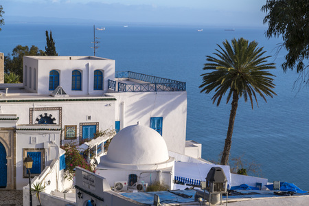 Typical Tunisian, Arabian, Mediterranean architecture in Sidi Bou Said, famous touristic town near Tunis, Tunisian capital.North African Mediterranean coast.
