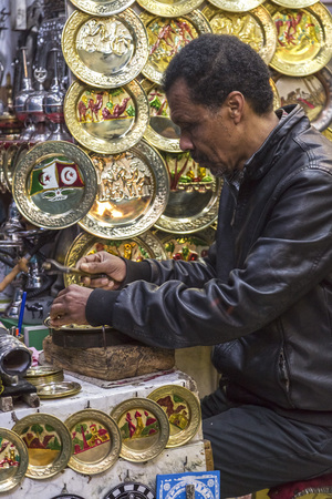 dirty: Tunis, Tunisia - December 27, 2016: Little shops and people shopping at the old souk of La Medina of Tunis city, Tunisia.