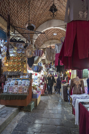 gold souk: Tunis, Tunisia - December 27, 2016: Little shops and people shopping at the old souk of La Medina of Tunis city, Tunisia.