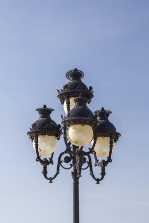 Ornate street light against the blue sky in Tunis, iron lantern