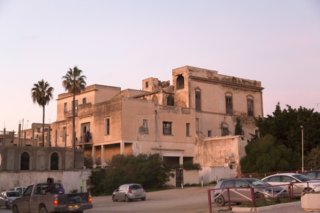 marsa: La Marsa, Tunisia - December 26, 2016: An obsolete building in La Marsa district of Tunis, orange evening light. Editorial