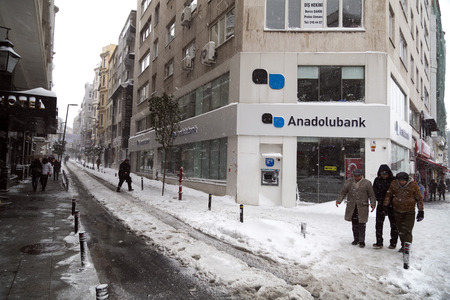 Istanbul, Turkey - January 8, 2017: Sisli Branch of Anadolubank on Rumeli Avenue on a snowy day. Anadolubank currently maintains 106 branches throughout Turkey and employs 1,750 personnel in total. Editorial