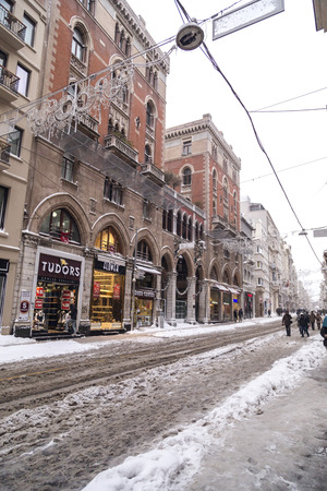 heavy snow: Istanbul, Turkey - January 7, 2017: Istanbul under heavy snow on January 7. The locals and visitors enjoy walking on snow on Istiklal Avenue and Taksim Square, Istanbul Turkey.