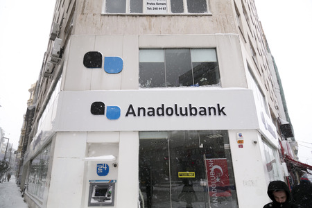 rumeli: Istanbul, Turkey - January 8, 2017: Sisli Branch of Anadolubank on Rumeli Avenue on a snowy day. Anadolubank currently maintains 106 branches throughout Turkey and employs 1,750 personnel in total. Editorial