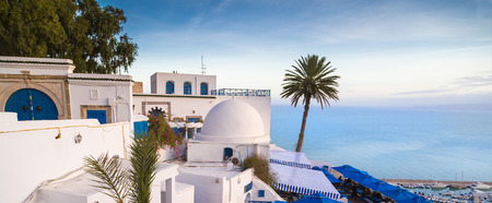 Typical Tunisian, Arabian, Mediterranean architecture in Sidi Bou Said, famous touristic town near Tunis, Tunisian capital.North African Mediterranean coast.