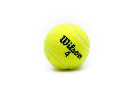 wilson: Istanbul, Turkey - March 10, 2017: Wilson brand tennis ball isolated on white. The Wilson Sporting Goods Company is an American sports equipment manufacturer based in Chicago, Illinois since 1989.