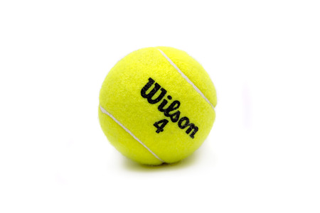 sporting goods: Istanbul, Turkey - March 10, 2017: Wilson brand tennis ball isolated on white. The Wilson Sporting Goods Company is an American sports equipment manufacturer based in Chicago, Illinois since 1989.