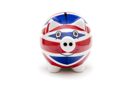 Porcelain piggy bank with UK flag print isolated on white