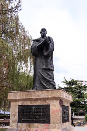 Skopje, Macedonia - April 9, 2017: Bronze sculpture of Pjeter Bogdani, famous Albanian writer in downtown Skopje, Macedonia Editorial