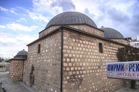 Skopje, Macedonia - April 5, 2017: Daut Pasha Hammam, old Ottoman Turkish bath structure, today used as an art gallery located at the Turkish neighborhood of Skopje, Macedonia