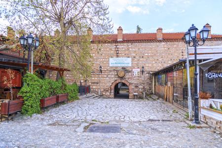 Skopje, Macedonia - April 5, 2017: Old Turkish bazaar and neighborhood of Skopje, the Macedonian capital. Entrance of Isa Bey Medrese.