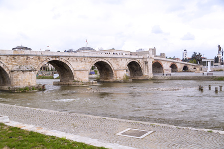 central european: Skopje, Macedonia - April 9, 2017: View from downtown Skopje, the Macedonian capital. Ottoman Stone Bridge and buildings around Vardar River