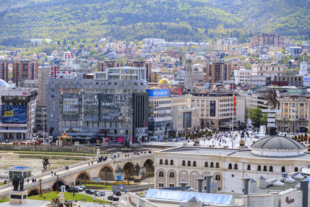 Skopje, Macedonia - April 5, 2017: View from downtown Skopje, the Macedonian capital. Buildings and monuments around Vardar River.