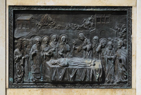 depiction: Skopje, Macedonia - April 5, 2017: Bronze carving relief with a religious depiction in Skopje, Macedonia