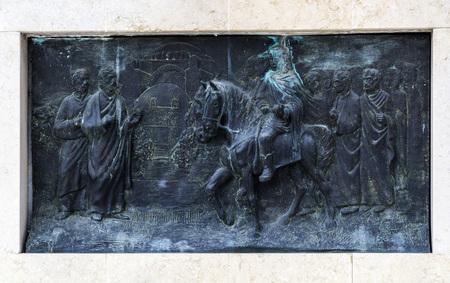 Skopje, Macedonia - April 4, 2017: Bronze carving with a historical scene depicted, Skopje, Macedonia