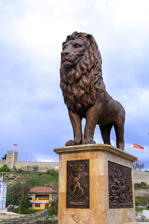 Skopje, Macedonia - April 5, 2017: Lion sculpture and Kale Fortress on the hill in Skopje, Macedonia.