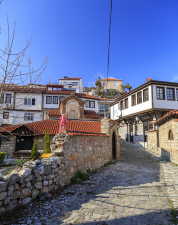 generic location: Ohrid, Macedonia - April 7, 2017: Generic architecture of Ohrid town in FYR Macedonia. Traditional Ottoman style residential buildings and tranquil streets.