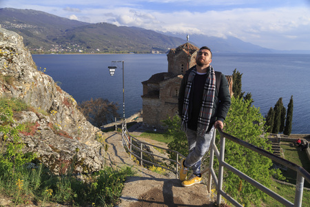 top 7: Ohrid, Macedonia - April 7, 2017: Tourist posing at the cliff-top church of Saint Joan at Kaneo or St. Jovan Kaneo over Ohrid Lake, Macedonia. Editorial