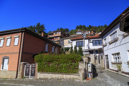 Ohrid, Macedonia - April 8, 2017: Generic architecture of Ohrid town in FYR Macedonia. Traditional Ottoman style residential buildings and tranquil streets.