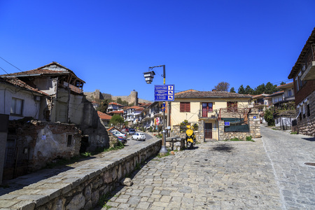 generic location: Ohrid, Macedonia - April 8, 2017: Generic architecture of Ohrid town in FYR Macedonia. Traditional Ottoman style residential buildings and tranquil streets.