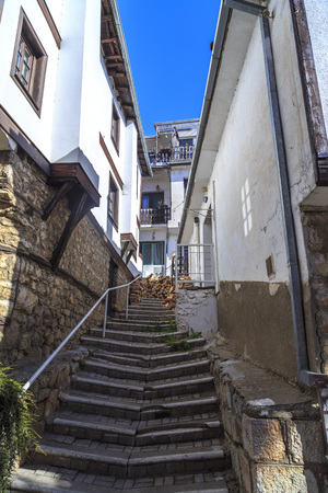 traditional culture: Ohrid, Macedonia - April 8, 2017: Generic architecture of Ohrid town in FYR Macedonia. Traditional Ottoman style residential buildings and tranquil streets.