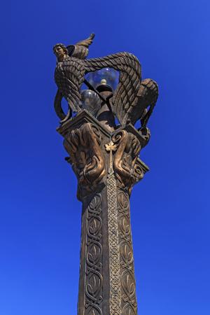 Macedonia, Skopje - April 9, 2017: Freedom Bridge, Bronze Seraphim light posts guard over the bridge from elevated pillars ove Vardar River. Stock Photo