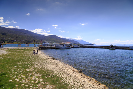 skiff: Ohrid, Macedonia - April 8, 2017: Coastal scene from Ohrid and the Lake Ohrid, southeast of FYR Macedonia.