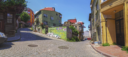 back alley: Istanbul, Turkey - May 28, 2017: Street view from Balat district of Fatih, Istanbul. Balat is one of the oldest neighborhoods in Istanbul with interesting architectural style and social diversity. Editorial