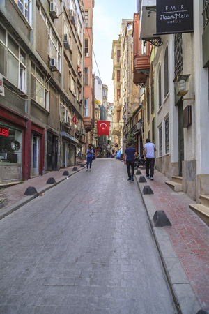 famous people: Istanbul, Turkey - May 14, 2017: Generic architecture and people walking in the back streets of the famous Istiklal Avenue. Editorial