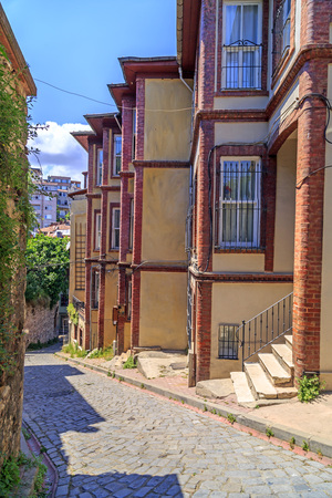 back alley: Street view from Balat district of Fatih, Istanbul. Balat is one of the oldest neighborhoods in Istanbul with interesting architectural style and social diversity.
