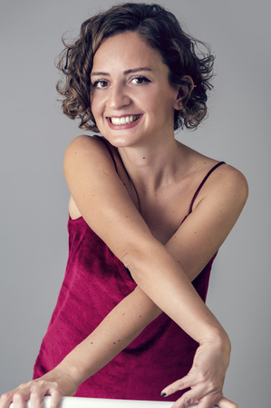 Young woman with short curly hair studio portrait Stock Photo