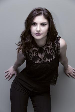 coloring lips: Young, beautiful, fresh casual female model, attractive girl studio portrait Stock Photo