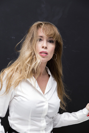 Beautifully aging blonde lady in white shirt, studio portrait 스톡 콘텐츠