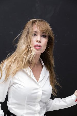 Beautifully aging blonde lady in white shirt, studio portrait Standard-Bild