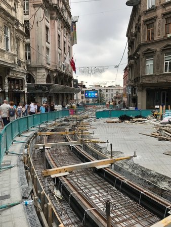 develope: Istanbul, Turkey - August 8, 2017: Renovation of Istiklal Avenue on August 8, 2017. The railway of the nostalgic tram being restorated. Stock Photo