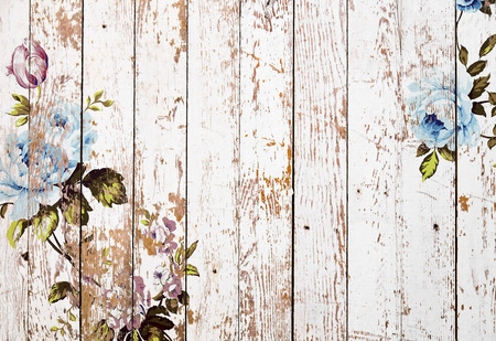Shabby chic vintage roses on white grunge wooden texture, authentic chintz floral background
