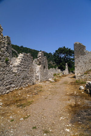 Ruins of Olympos ancient site in Antalya, Turkey. The ancient civilization was built on the Mediterranean coast. Фото со стока