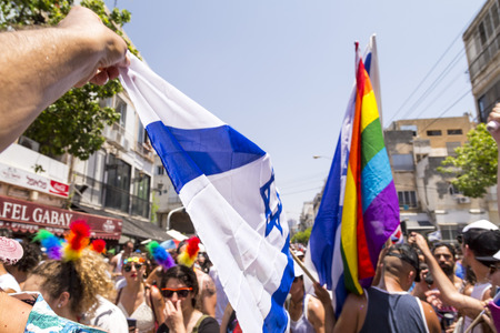 Tel Aviv, Israel - June 8, 2018: 20th annual Tel Aviv Pride Week.At the parade, people walking, dancing, singing, waving banners and rainbow flags celebrating the largest LGBT event in the middle east Redactioneel