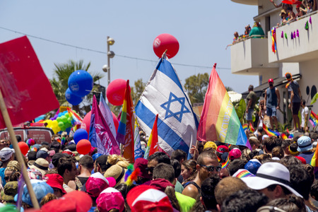 Tel Aviv, Israel - June 8, 2018: 20th annual Tel Aviv Pride Week.At the parade, people walking, dancing, singing, waving banners and rainbow flags celebrating the largest LGBT event in the middle east