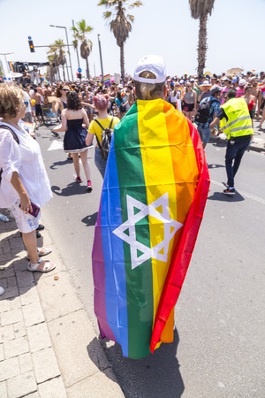 Tel Aviv, Israel - June 8, 2018: 20th annual Tel Aviv Pride Week.At the parade, people walking, dancing, singing, waving banners and rainbow flags celebrating the largest LGBT event in the middle east Stok Fotoğraf - 104406577