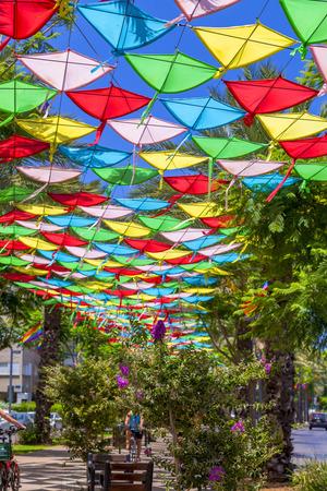 Tel Aviv-Yafo, Israel - June 9, 2018: Colorful kites covering the pedestrian way in Sderot Hen Street in tel Aviv, Israel on June 9, 2018.